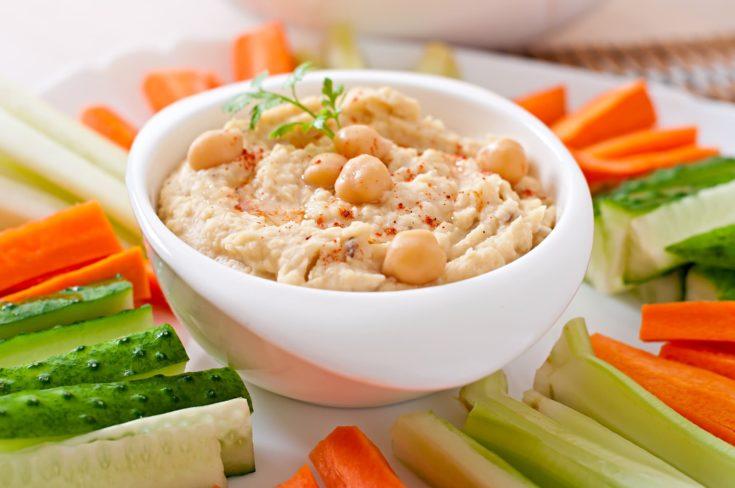 Tasty hummus with vegetables on plate
