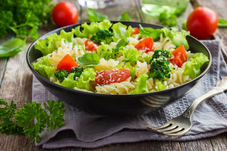 Pasta salad with cherry tomatoes and broccoli, selective focus
