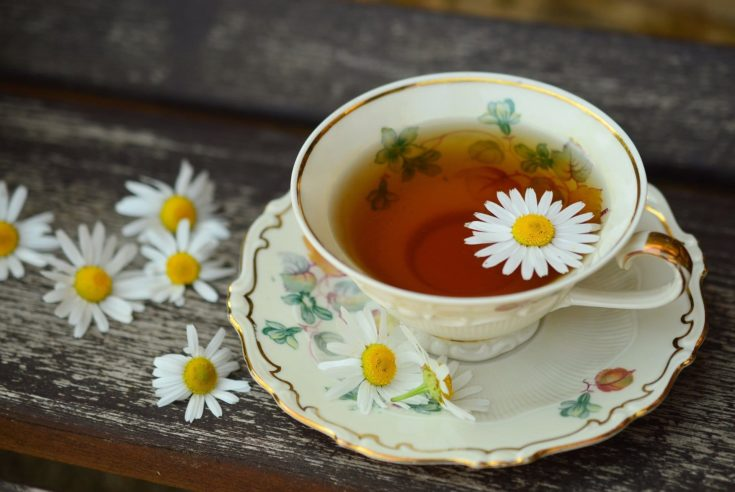 Tea on a porcelain cup and saucer.