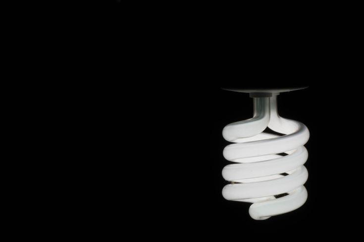 cfl bulb in black background