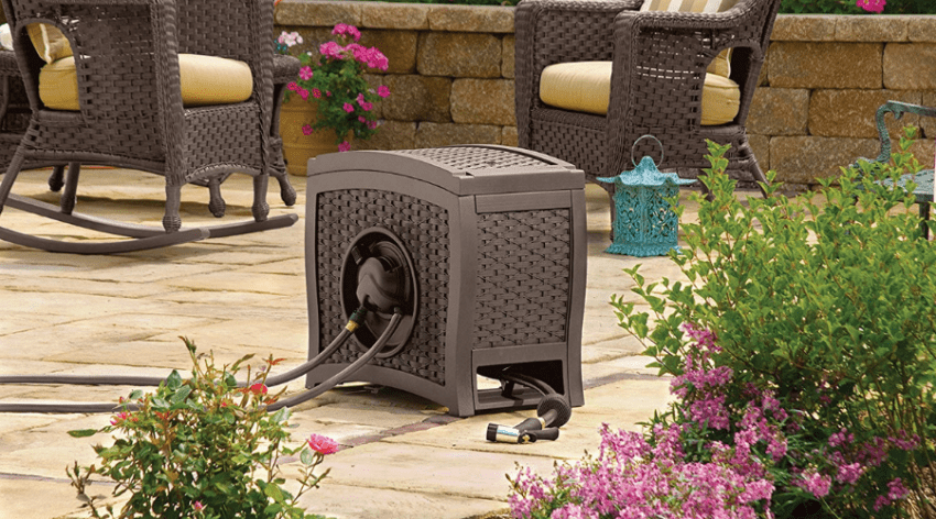 a wicker garden hose reel sitting on a patio