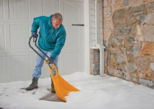Man shoveling snow with a True Temper snow shovel