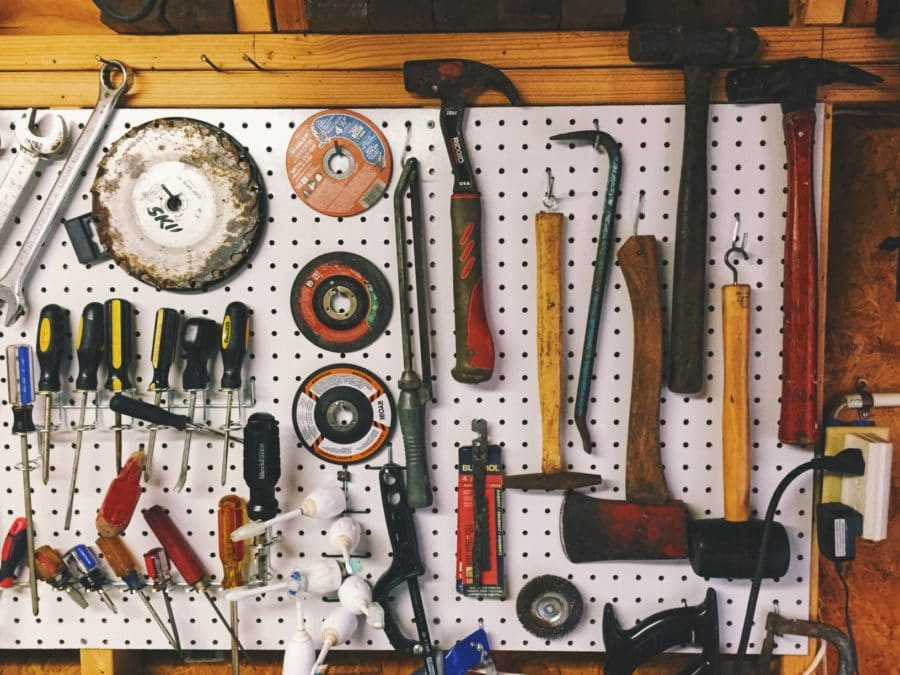 household tools hanging on pegboard storage in garage