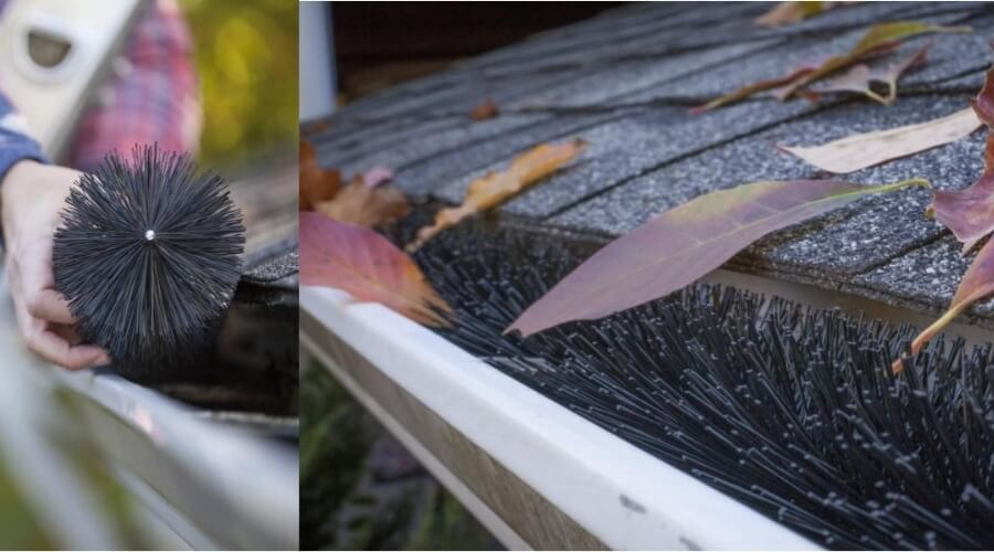 A gutter brush placed in the gutter with dried leaves on top of the gutter brush