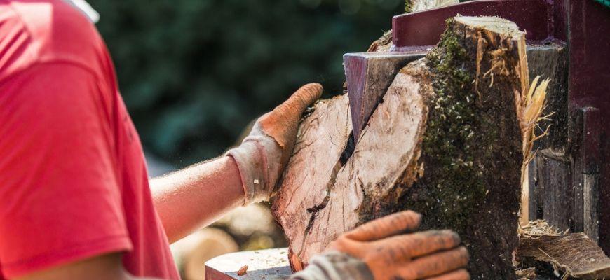 Man split the wood using log splitter