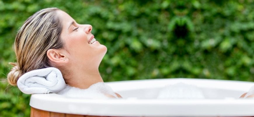 woman inside the hot tub smiling