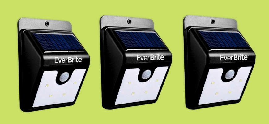 Three Ever Brite Solar Led Lights in a yellow green background.
