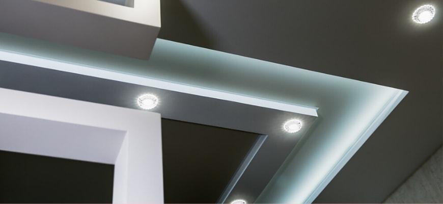 Solar tubes lighted on a ceiling.