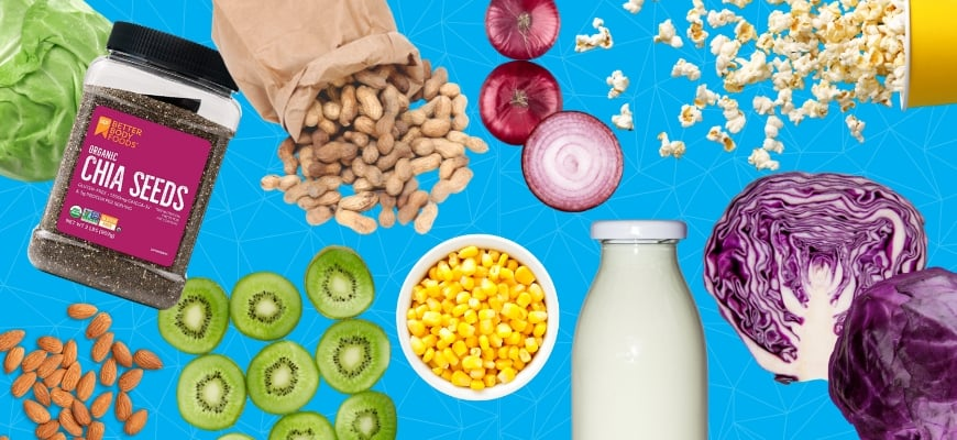 Different kind of healthy foods like milk,nuts and vegetables on a blue background.
