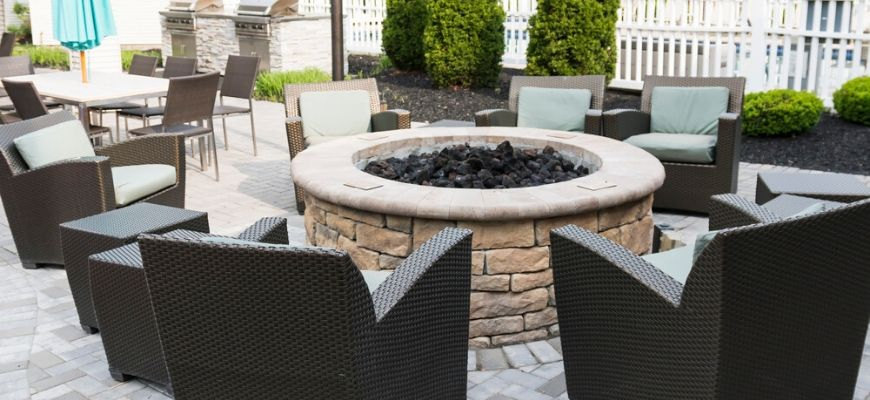 fire pit surrounded by chairs