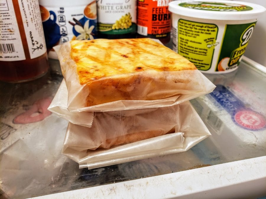 wrapped cheese siting in the fridge