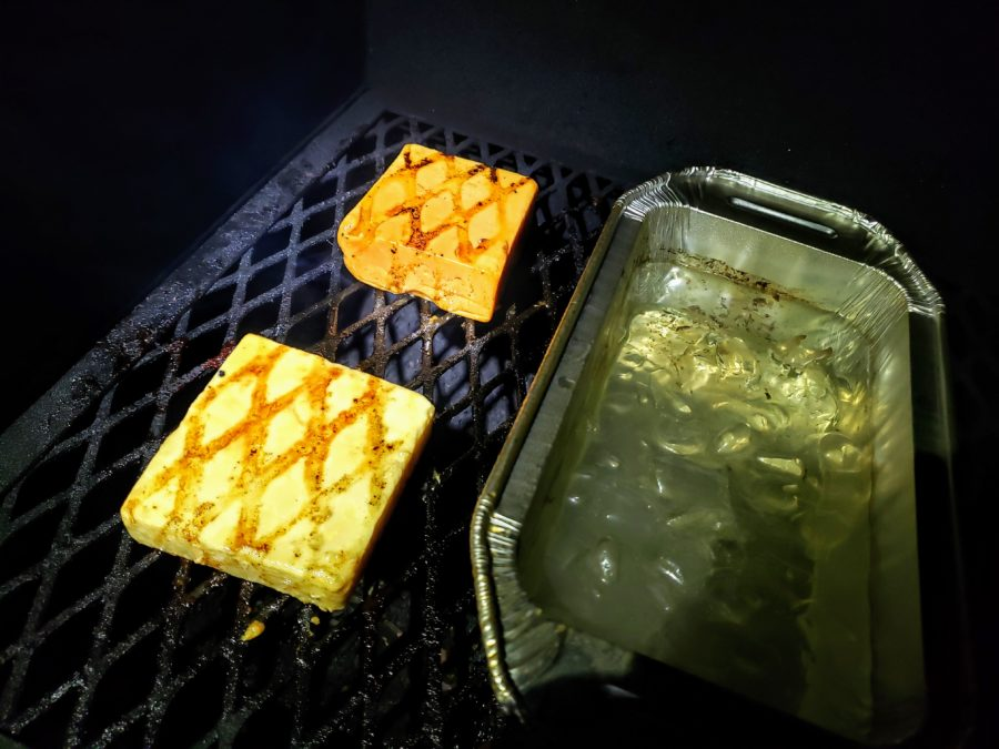 cheese on the smoker with ice bath between them