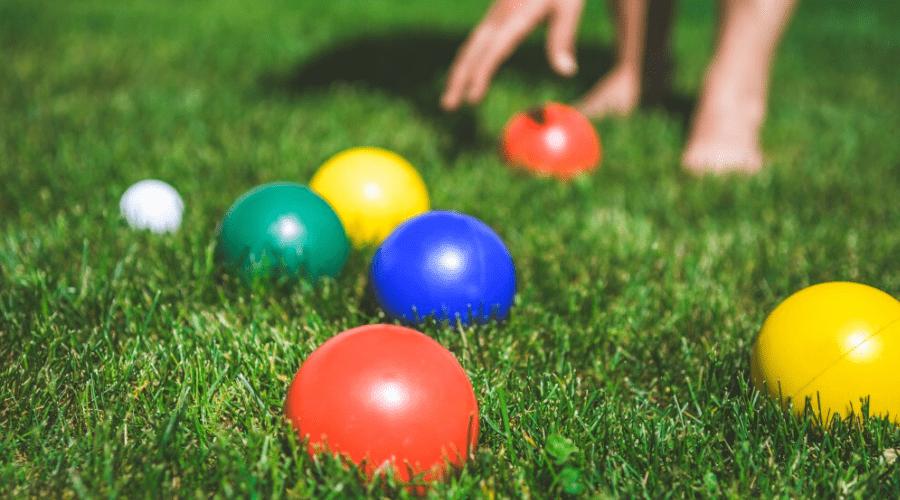 backyard game bocce balls in grass