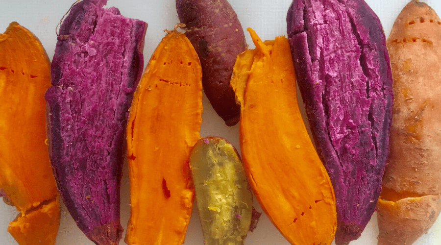 white purple and orange sweet potatoes in half