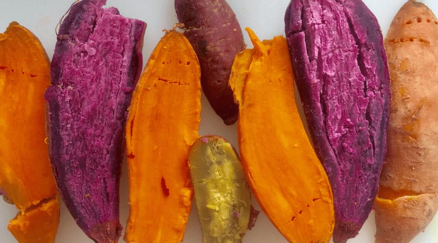 white purple and orange sweet potatoes in half