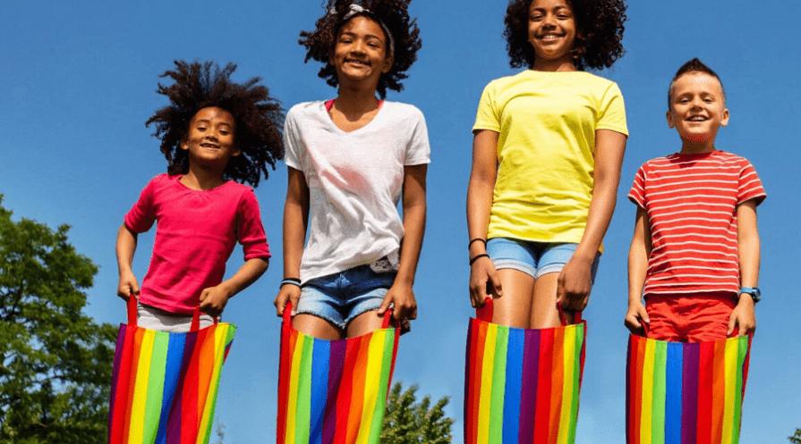 four kids in rainbow sack race