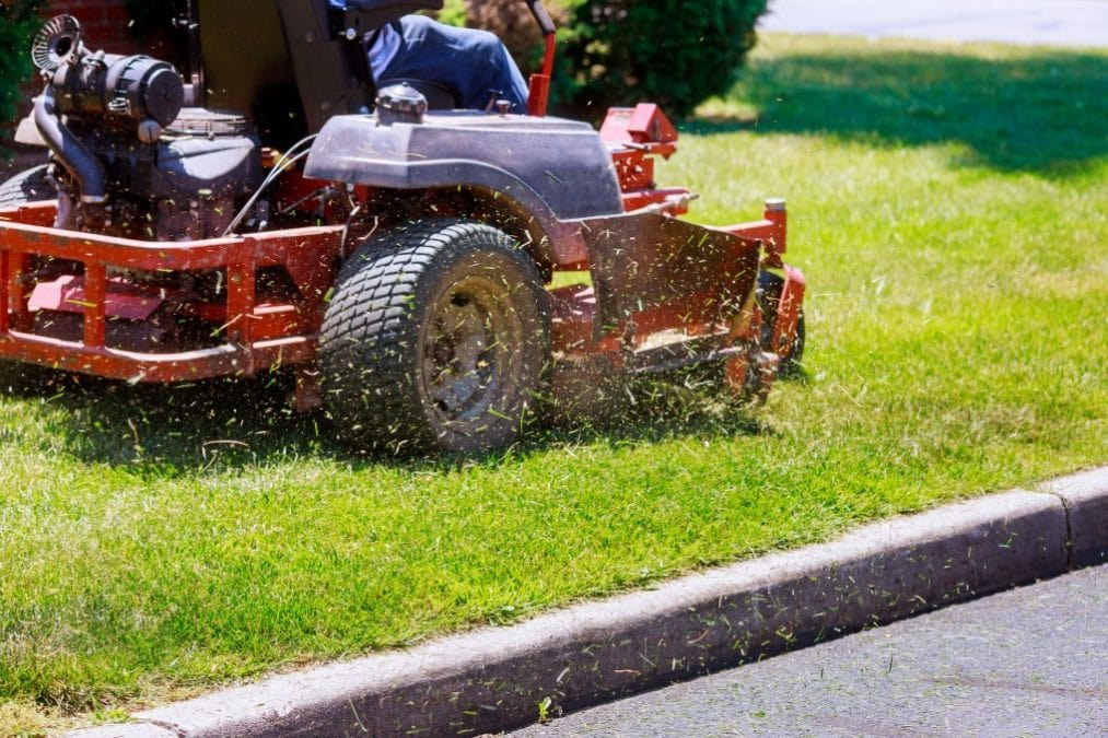 Red Small Riding Lawn Mower in action cutting grass