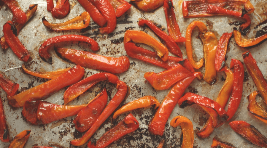 roasted bell pepper strips on a sheet pan