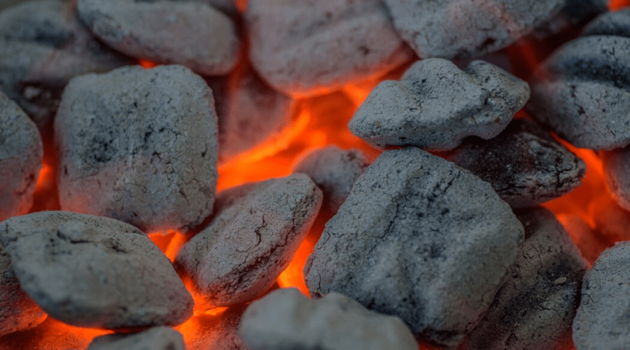 closeup glowing charcoal briquettes