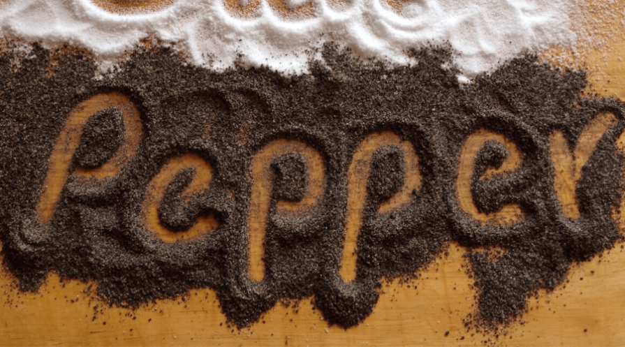 the word pepper spelled in negative in ground black pepper