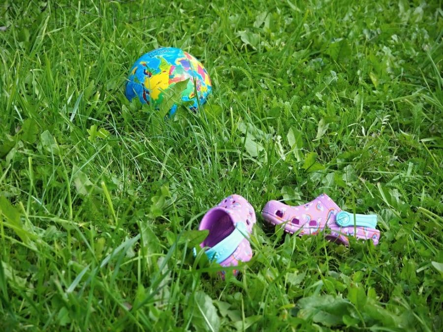 childrens outdoor game steal the bacon ball or shoe in grass
