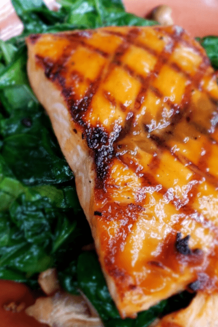 grilled salmon on sauteed greens