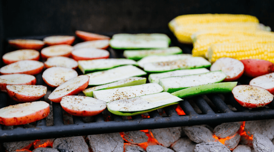 potatoes zucchini and corn on hot charcoal grill