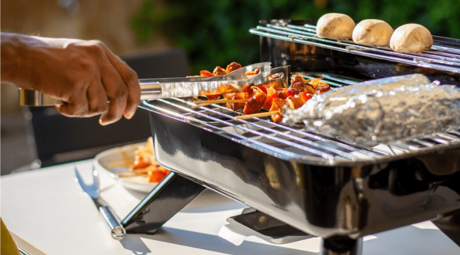 Grilling on a hybrid grill barbecue for electric or charcoal outdoors
