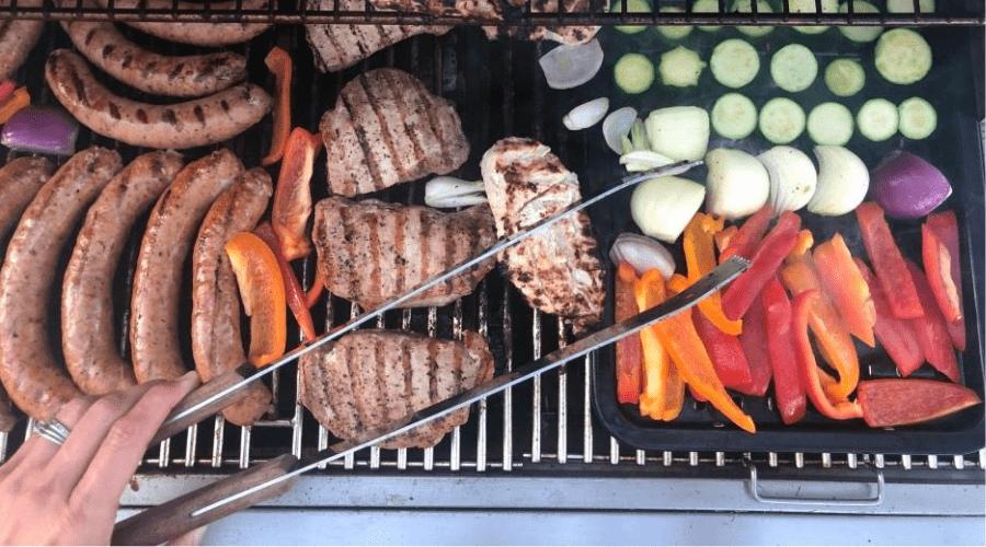 backyard bbq grill tongs and veg overhead