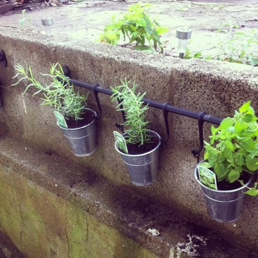 container herb garden from patio railing in small space