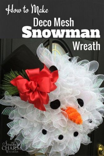 A volumous snowman wreath made from garland and mesh.