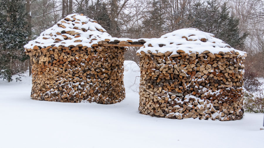 holz hausen firewood stacks in snowy outdoors