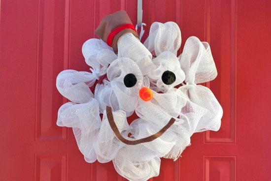 A snowman wreath made from mesh.