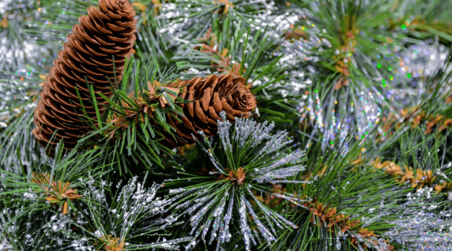 artificial tree closeup of needles realistic flocking and artificial pine cones