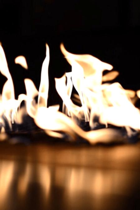breeo fire pit closeup lip lit fire reflecting