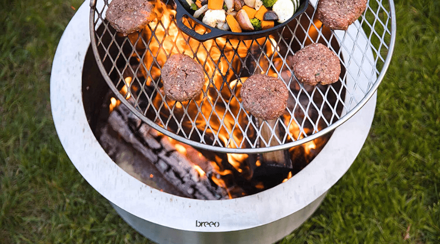 breeo smokeless fire pit with cooking grill grate overhead with burgers