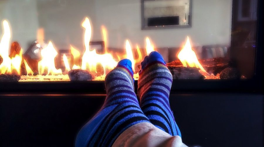 gas fireplace in use with socked feet