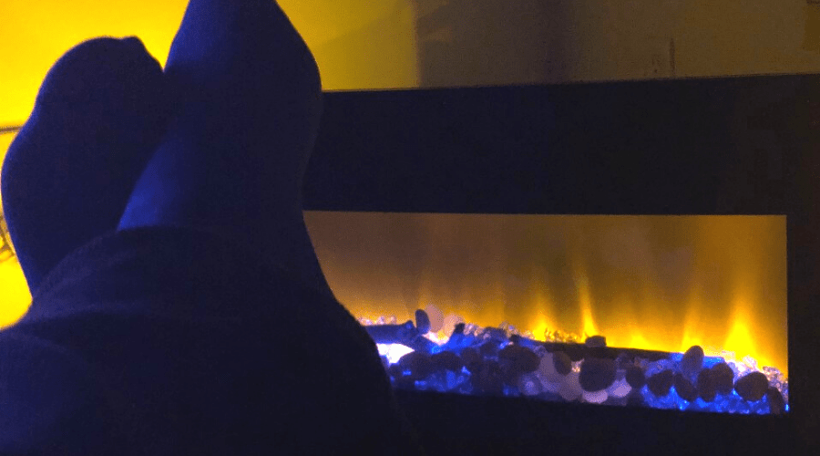 electric fireplace in use feet up in the dark