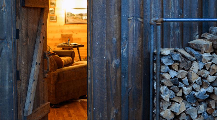 firewood rack DIY outdoors cabin open door horizontal lead