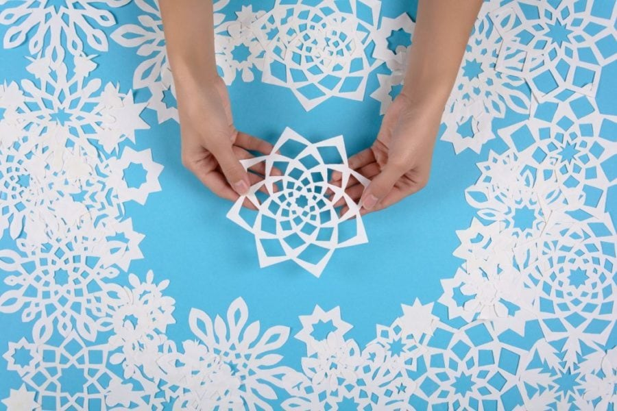 paper snowflakes on blue background
