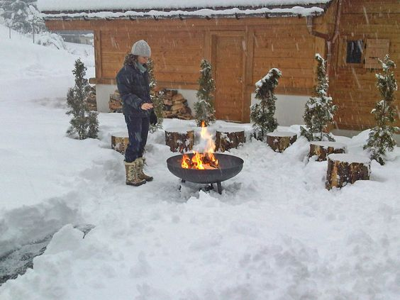 logs and stumps used as firepit seating in winter