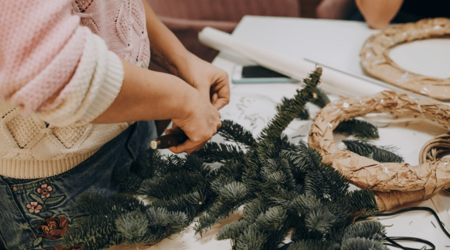 reuse Christmas tree branches by making wreaths with needles