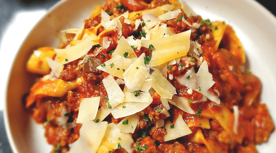 pasta bolognese in bowl with cheese closeup crockpot recipes