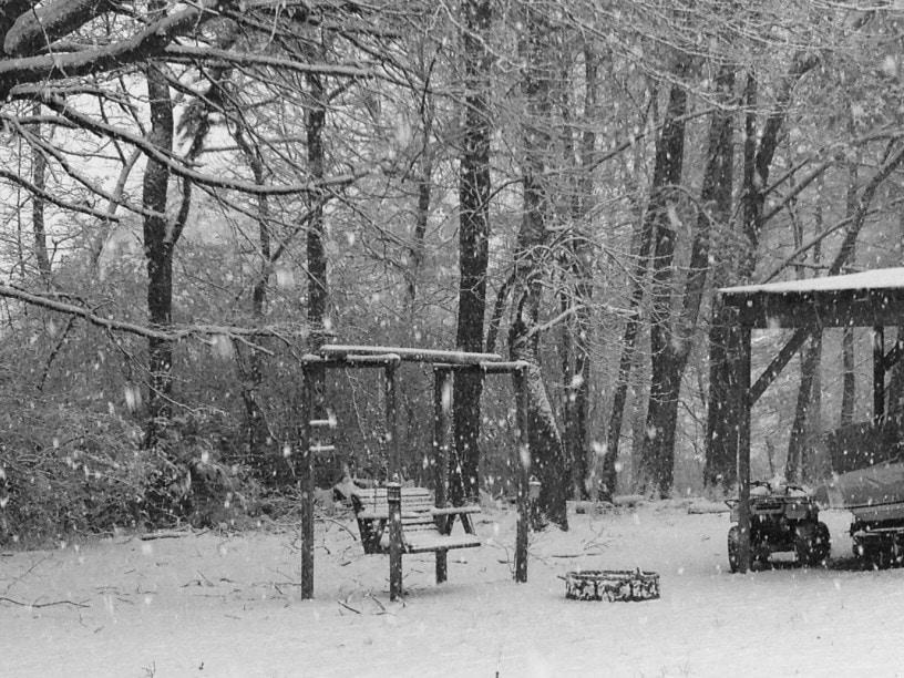 swing near fire pit in winter