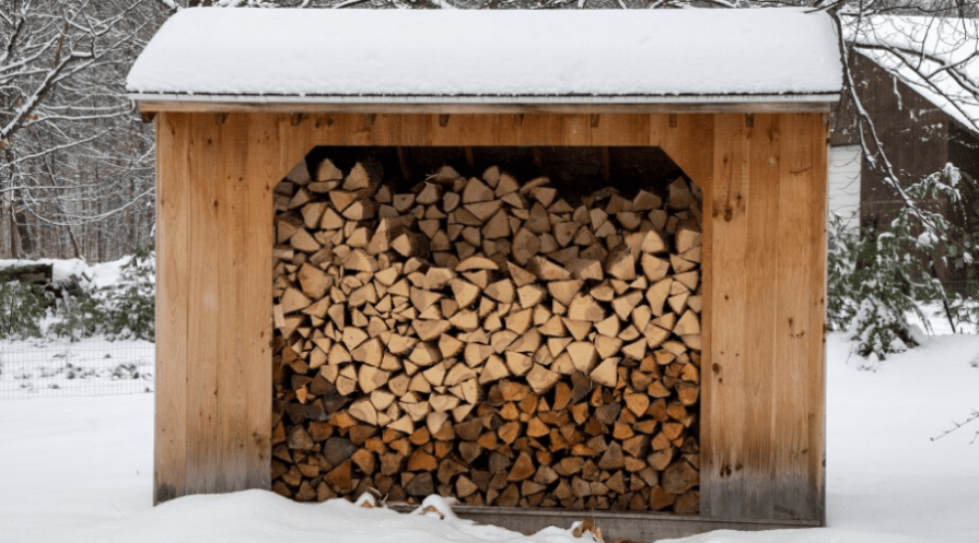 a woodshed holding nearly a cord of firewood in winter