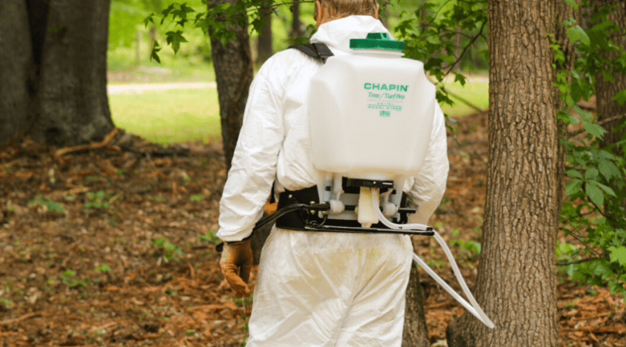 best backpack sprayer wide featured man wears backpack sprayer to treat wooded area