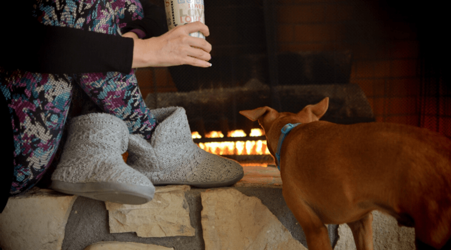 Woman drinking coffee in front of the fireplace wearing leggings and cozy slippers in the morning, love is cup, Puppy, rescue dog,