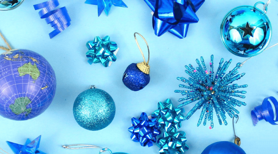 blue ornaments and bows on a blue background