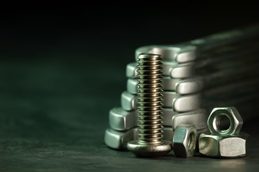 bolt nuts and wrenches on dark background