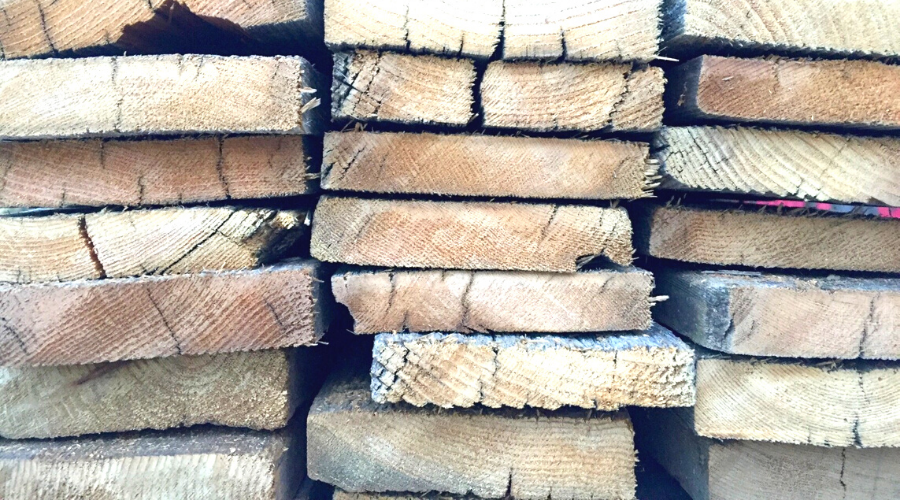stacked dried cedar planks outdoors closeup